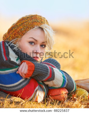 Portrait of a sad young woman outdoor in autumn.
