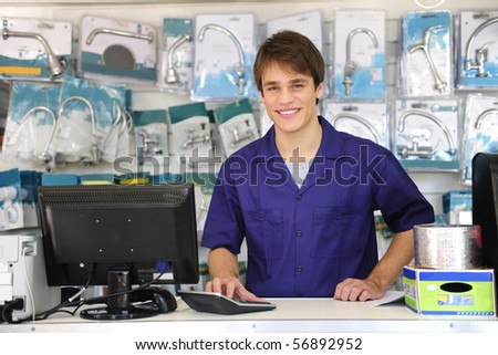 portrait of a sales assistant behind the counter of a building  center