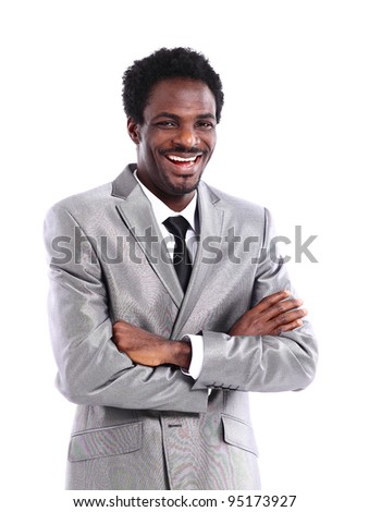 Portrait of a satisfied young African American business man with hands folded on white