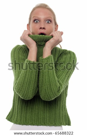 portrait of a scared young caucasian woman with green turtleneck