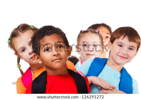 Portrait of a school aged African American boy and his friends behind