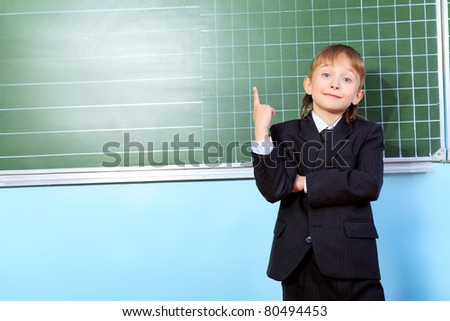 Portrait of a schoolboy in a classroom.