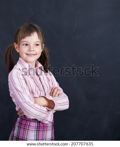 Portrait of a schoolchild on a background of the board. School and education