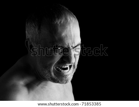 Portrait of a screaming mad man, isolated on black