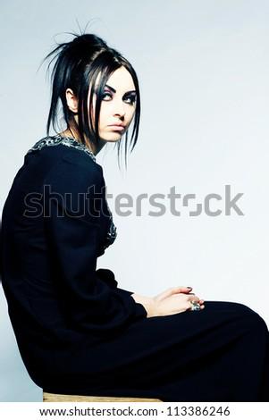 Portrait of a seductive caucasian woman in an elegant black dress
