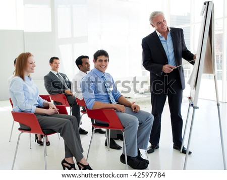 Portrait of a senior businessman giving a conference in the office