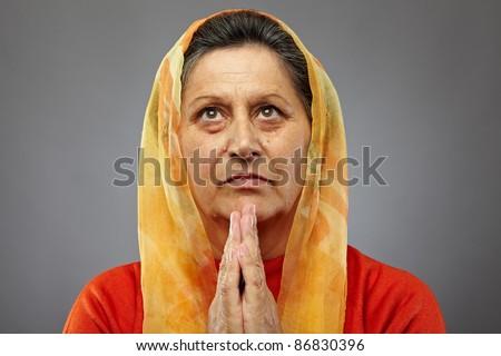 Portrait of a senior caucasian woman praying