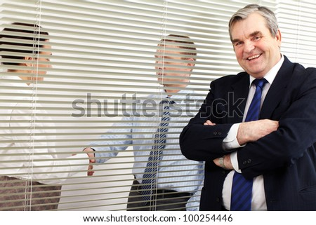 Portrait of a senior chief looking at camera in office