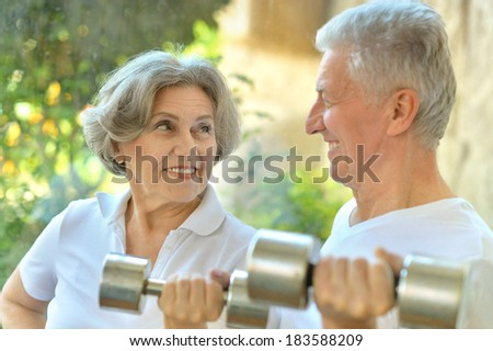 Portrait Of A Senior Couple Exercising Outdoors - stock photo