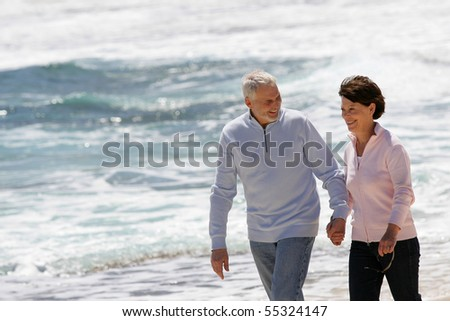 Portrait of a senior couple walking by the seaside