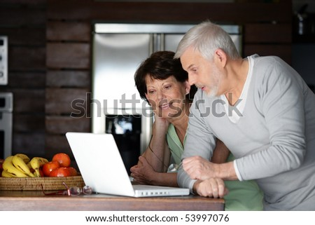 Portrait of a senior couple with a laptop computer