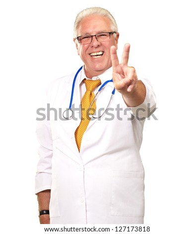 Portrait Of A Senior Doctor On White Background