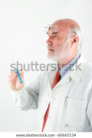 Portrait of a senior doctor with injection