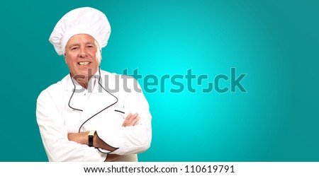 Portrait Of A Senior Male Chef On turquoise Background
