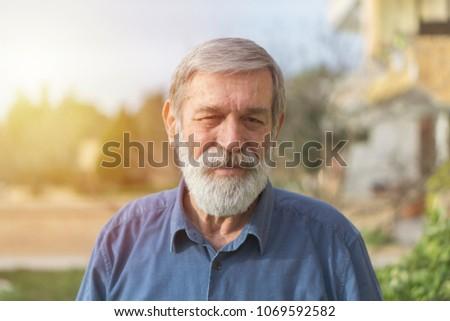 Portrait of a senior man  #1069592582