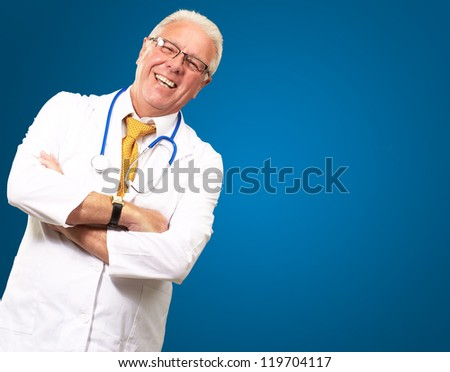 Portrait Of A Senior Man Doctor Isolated On Blue Background