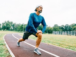 portrait of a senior man exercising and running outdoors