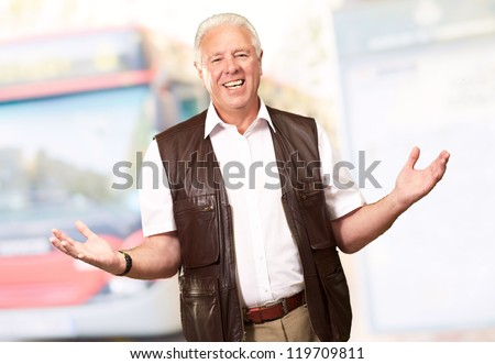 Portrait Of A Senior Man Presenting, Outdoor