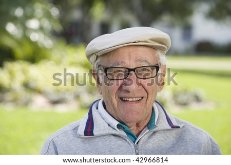 Portrait of a senior man smiling. Horizontally framed shot.