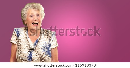 Portrait Of A Senior Woman Happy On Pink Background