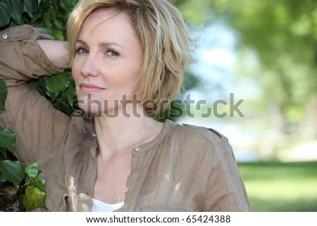 Portrait of a senior woman in a garden