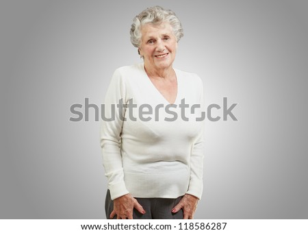 Portrait Of A Senior Woman On Gray Background