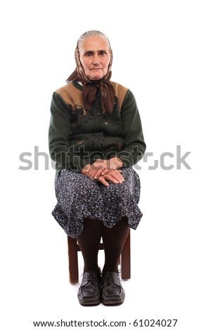 Portrait of a senior woman sitting on chair, isolated on white background