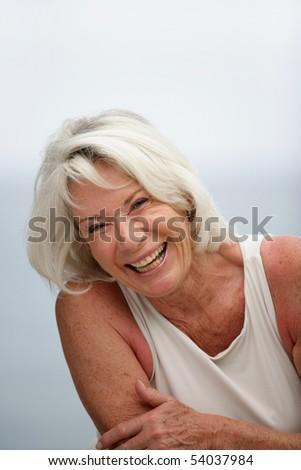 Portrait of a senior woman smiling - stock photo