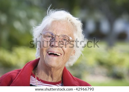 Portrait of a senior woman smiling. Horizontally framed shot.