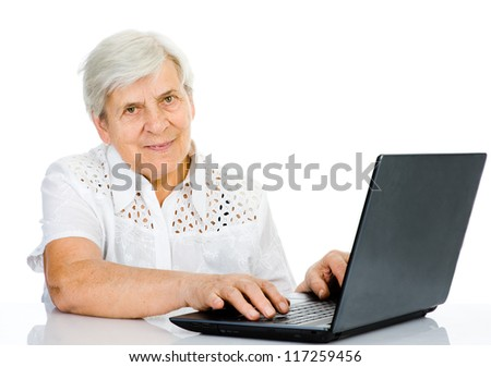 Portrait of a senior woman using laptop. looking at camera. isolated on white background