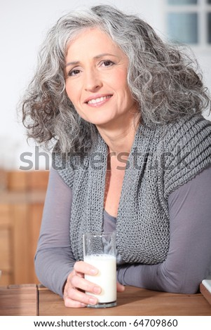 Portrait of a senior woman with a glass of milk
