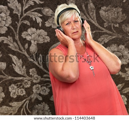 Portrait Of A Senior Woman With Headphone On Wallpaper