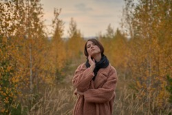 Portrait of a sensual girl in the autumn forest.