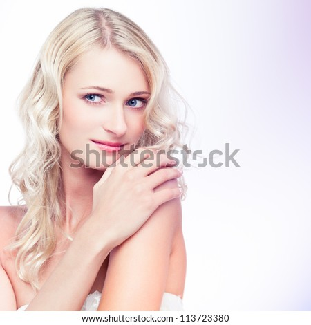 Portrait of a sensual young blond woman on white background