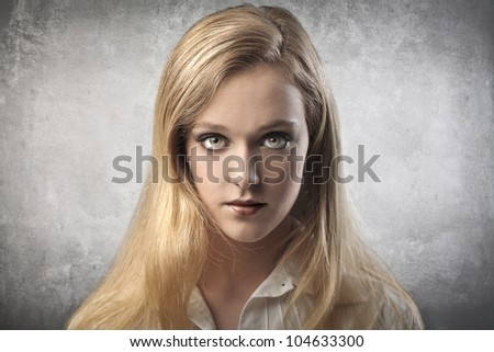 Portrait of a serious beautiful young woman