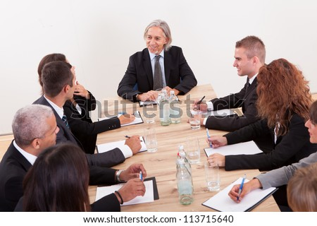 Portrait Of A Serious Business Men And Women Attending A Seminar