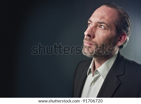 Portrait of a serious mature man isolated over colored background
