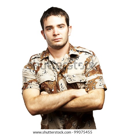 portrait of a serious young soldier standing against a white background