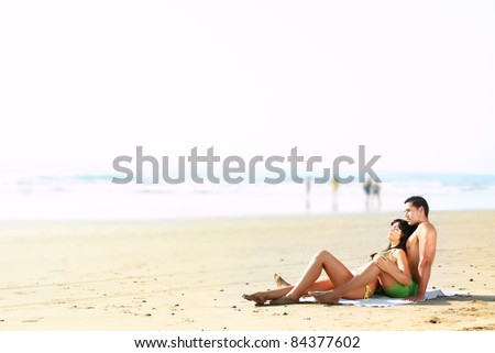portrait  of a sexy couple lying on the beach