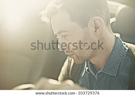 Portrait of a sexy fashion man in the car