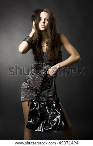 portrait of a sexy girl with a bag