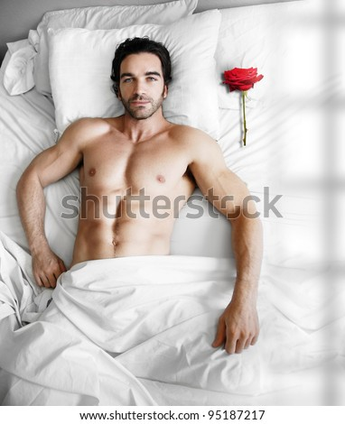 Portrait Of A Sexy Muscular Male Model Waiting In Modern Bed With ...