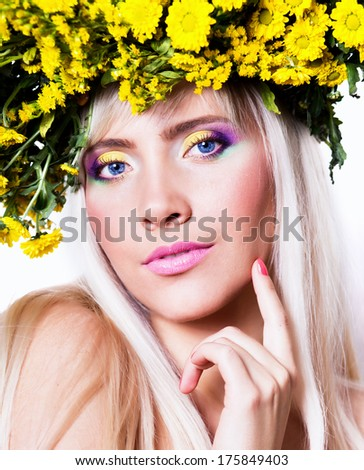 Portrait of a sexy woman with wreath of yellow flowers on the head.  - stock photo