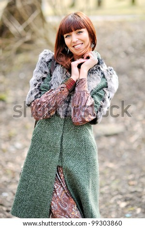 Portrait of a sexy young female smiling in a park - Outdoor