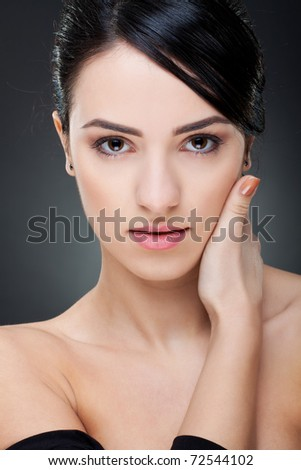 stock photo : Portrait of a sexy young girl touching her face with hand ...