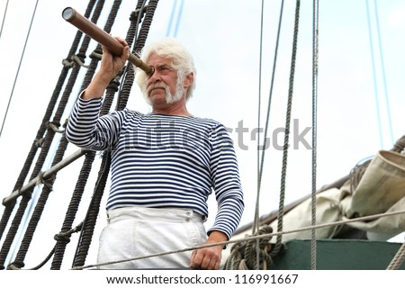Portrait of a ship captain with gray hair