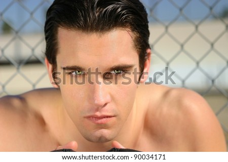 Portrait of a shirtless, attractive and serious young man
