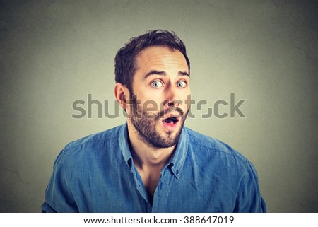 Portrait of a shocked young man in full disbelief