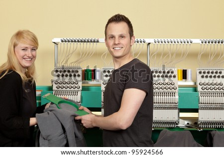 Portrait of a shop assistant and a Young Man in her Textile embroidery Shop