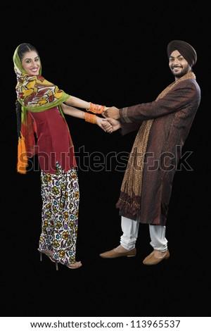 Portrait of a Sikh couple dancing